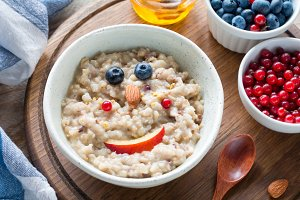Kids meal oatmeal porridge with fruits