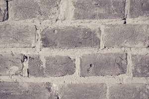 Gray grunge brick wall background.