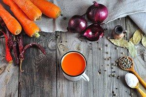Carrot juice in an iron mug