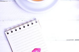 Empty notepad with a lipstick