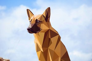 Guard dog German shepherd in polygons style