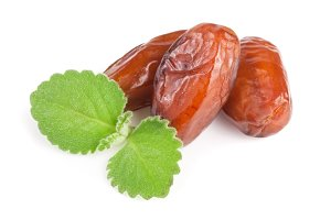 three dates with mint leaves isolated on white background
