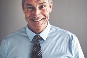 Smiling mature businessman wearing a shirt and tie