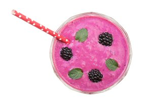blackberry yogurt or smoothie with mint leaves isolated on white background. Top view. Healthy Eating