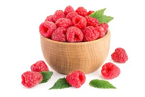 Raspberry in a wooden bowl isolated on a white background