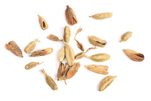 Dried cardamom seeds isolated on white background top view