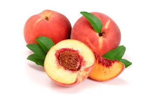 Peaches and half with green leaf isolated on white background