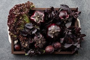 Wooden tray with purple vegetables