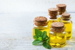 Organic essential oil with green mint leaves, spa concept