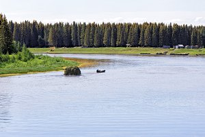 Siberia. Farmers on the boat carrying the harvested hay