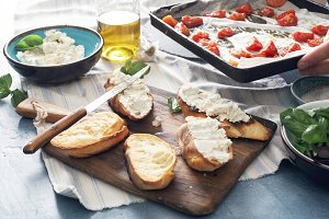 Bruschetta with baked tomato, garlic