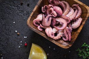 Seafood Baby octopus salad in a wooden bowl closeup