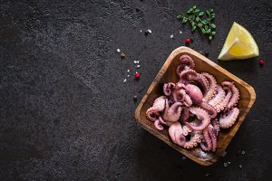 Seafood Baby octopus salad in a wooden bowl. Top view with copy