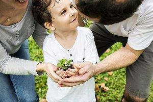 Family planting at park