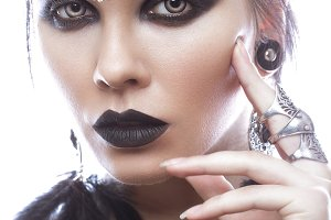 Beautiful girl in style of black queen. Image for a Halloween. Photos shot in the studio