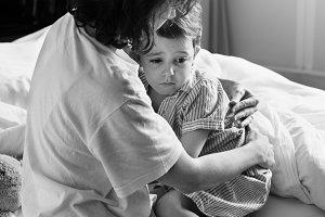 Mother hugging her son