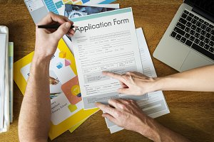 People filling application form