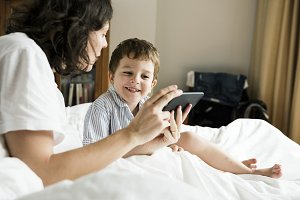Mother and son using smart phone
