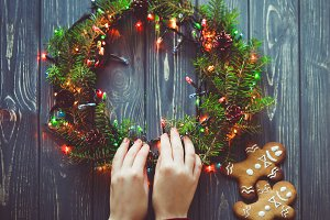 Woman make Christmas wreath