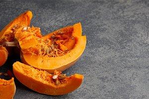Pumpkin slices on stone background