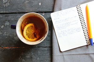 writer or school idea, tea and notebook on the table