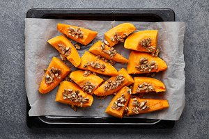 Baked pumpkin slices with walnuts