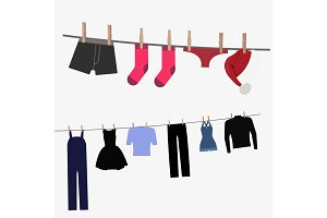 Colorful clothing hung by old wooden pegs