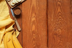 Wooden background with bananas