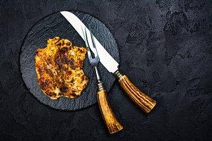 Chicken steak on slate board