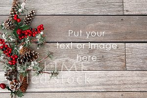 Christmas pine cones wood background