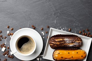 Cup of coffee and french eclairs