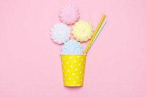 Vanilla desert on a pink background. Minimal style