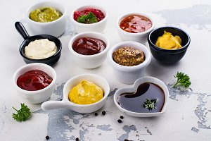 Various sauces and dips in porclean bowls