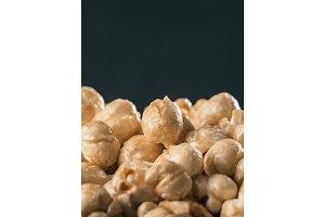 pile of caramel corn on black background