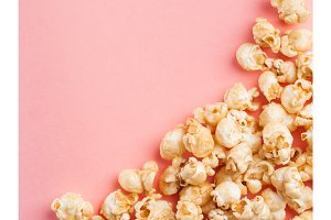 popcorn on pink background with copy space