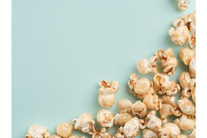popcorn on blue background with copy space