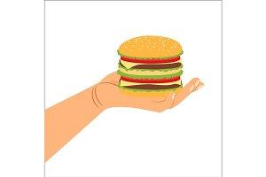 Hand holding hamburger