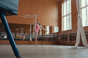 Athlete young woman is Training with gymnastic hoop