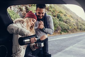 Couple on road trip having coffee