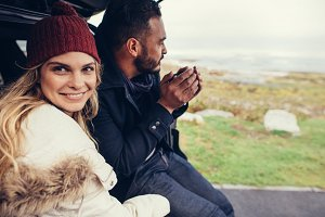 Couple on road trip during winter