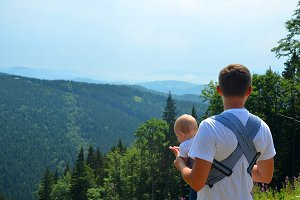 Happy family. Father carrying child girl outdoor enjoy nature. Portrait dad and daughter. Positive human emotions, feelings, joy. Mountains. Family tip.