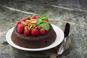 chocolate nut brownie cake decorated with raspberry