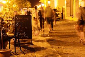 view of illuminated street cafe