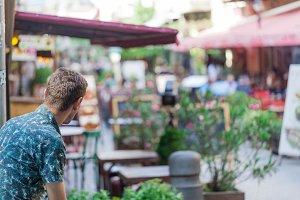 traveller sitting at street cafe