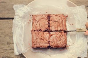 Cutting homemade brownie