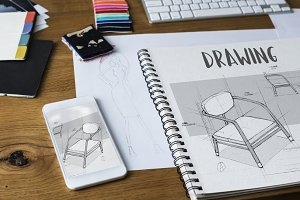 Designer drawing sketchbook