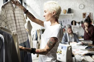 Fashion designer working in showroom