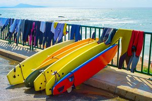 Surfboards and wetsuits drying