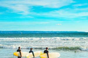 Group of surfers going to surf