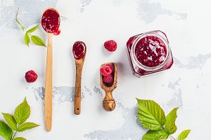 Raspberry jam in a wooden spoon